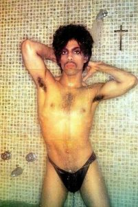 prince in shower with cross